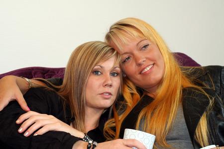 homosexual partners: women flirting Stock Photo