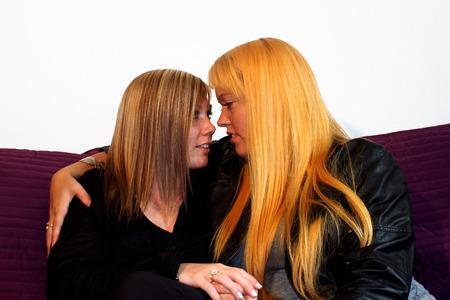 flirting women: women flirting Stock Photo