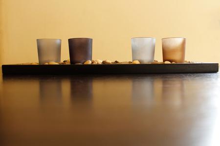 unlit: Four Unlit Candles On Stones Stock Photo