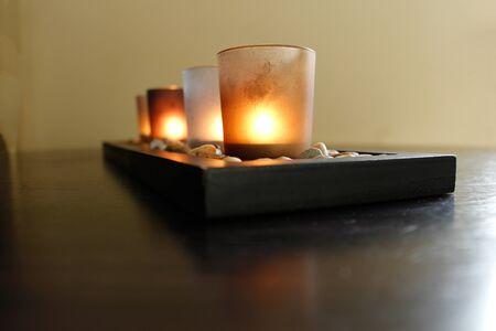 couple lit: Four Lit Candles On Stones