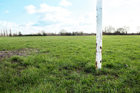 motivations: A Close Up Of A Goal Post On A Field In The Sun With Blue Sky And Clouds
