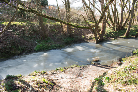 flowing river: A Fast Flowing River In The Wild On A Beautiful Sunny Summers Day