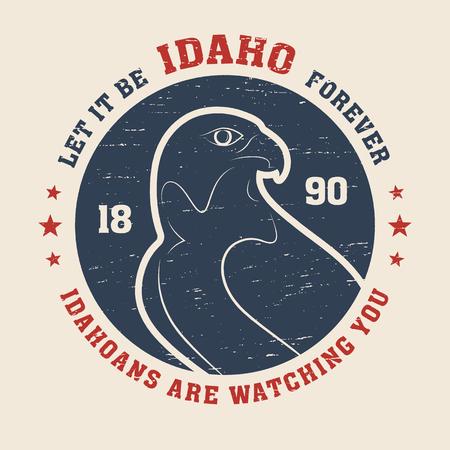 Idaho t-shirt design, print, typography, label with peregrine. Vector illustration. Illustration
