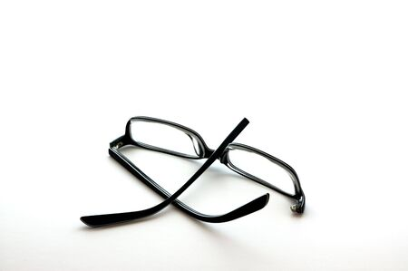 bifocals: Glasses with a broken arm isolated on white Stock Photo