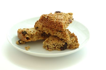 Flapjack oat bars on a plate isolated on white photo