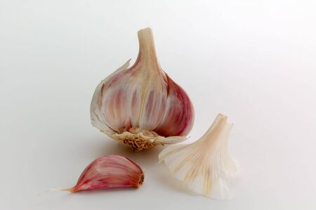 pungent: Garlic with Cloves and skin isolated on white Stock Photo