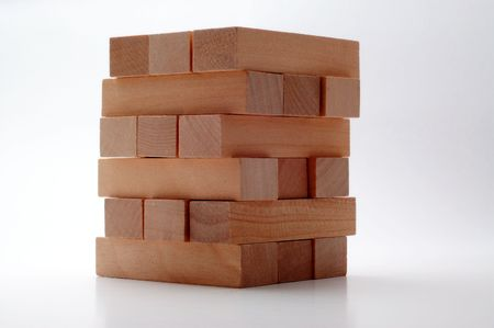 adjacent: Six tiers of wooden blocks in perpedicular rows of three isolated on white