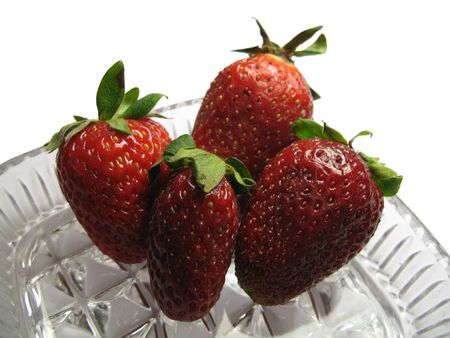 four strawberries in the glass crockery