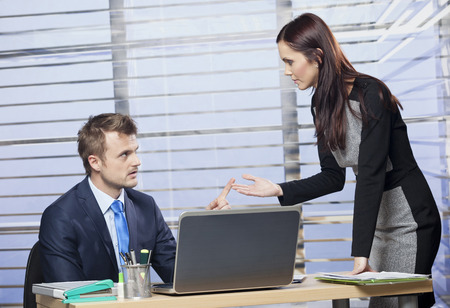 people arguing: Two business people arguing in office
