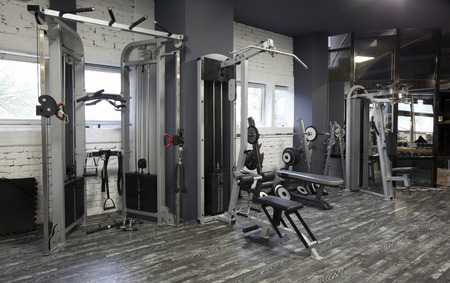 weight machine: Exercise machines in a gym