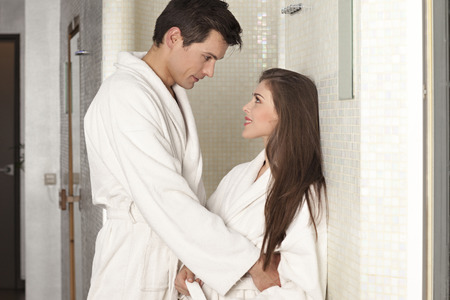 gazing: Couple in bathrobes gazing into each other s eyes