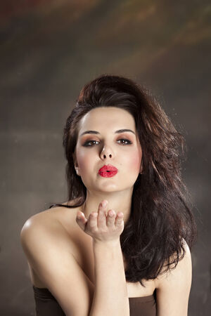 Pretty woman blowing a kiss photo