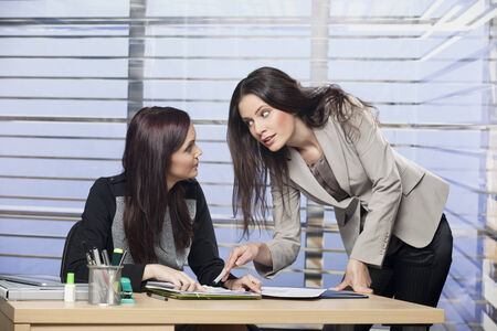 Two women discussing a problem in office