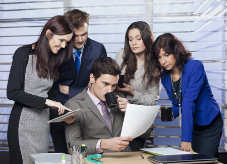 curiously: Business people looking at document curiously Stock Photo