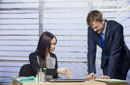 embarassed: Manager showing employee where he made a mistake