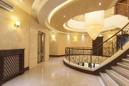 Beautiful chandelier in hotel interior photo