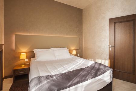 Modern hotel bedroom interior photo