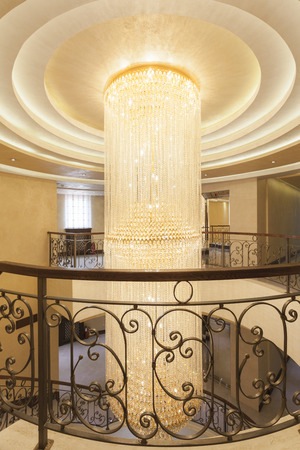 Beautiful crystal chandelier in hotel interior photo