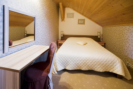 incline: Small room with incline ceiling
