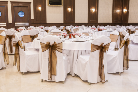 ceiling plate: Arranged tables at banquet hall Stock Photo