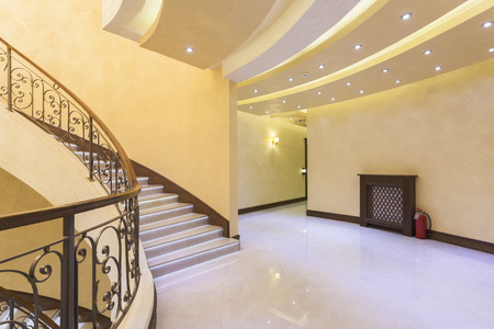 Bright hotel corridor with led light stairs photo