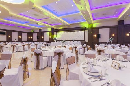 Wedding hall with colorful lights photo