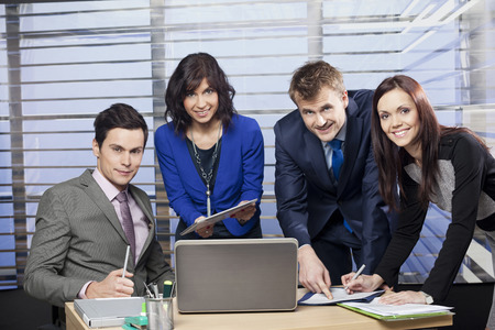 オフィスで働くビジネスの成功チーム 写真素材