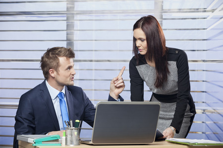 point of demand: Boss criticizing employee in office