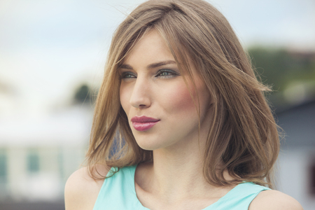 Outdoors portrait of a beautiful woman photo