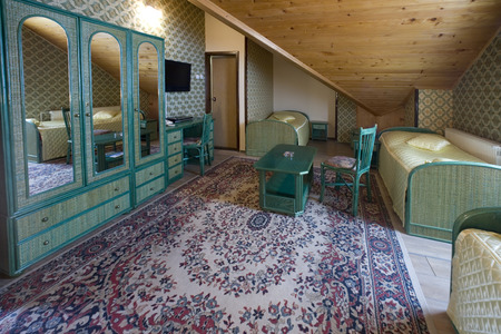 oriental rug: Vintage room with weave furniture Stock Photo