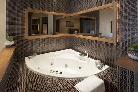 Modern open bath tub in room Stock Photo