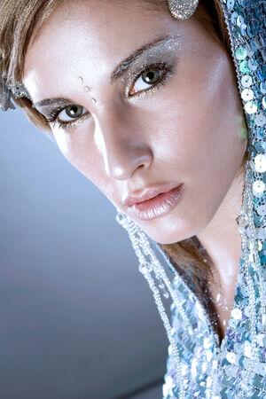 Beautiful woman with winter-theme make-up photo