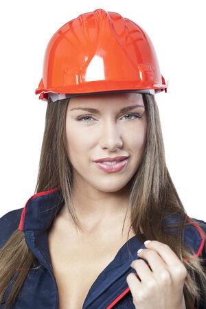 Portrait of a confident woman in industrial uniform photo