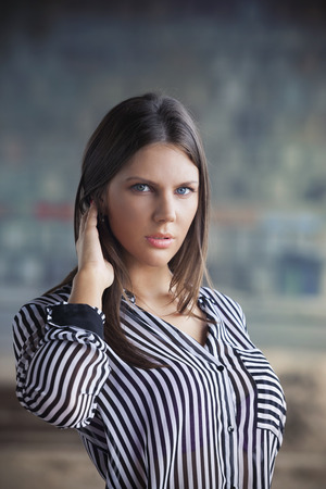 Portrait of a beautiful girl in striped shirt photo