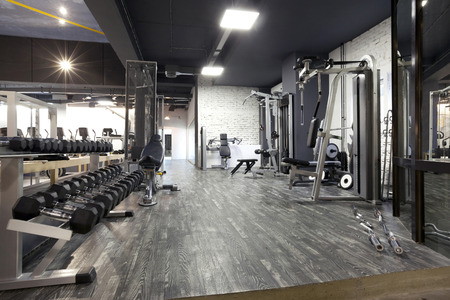 gym room: Modern gym interior with various equipment