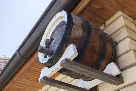 Small barrel with tap as decoration on a winery photo