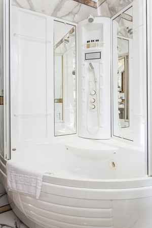 Modern jacuzzi and shower cabin photo