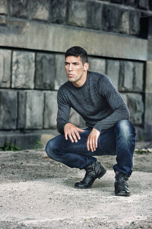 Outdoors portrait of a handsome man in jeans Stock Photo