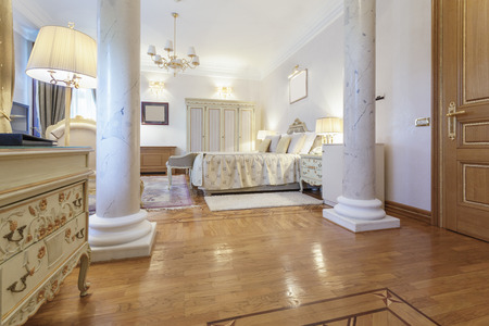 Interior of a classic style luxury bedroom with marble pillars photo