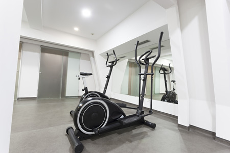 elliptical: Elliptical trainer and bike in exercise room