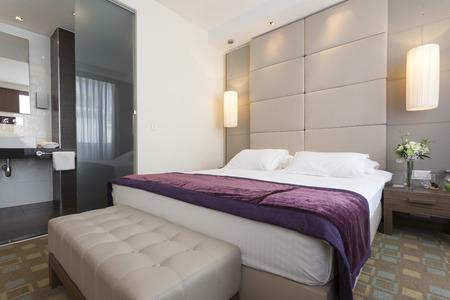 Luxury bedroom interior with bathroom photo