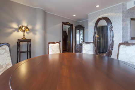Round table and chairs in elegant dining room photo