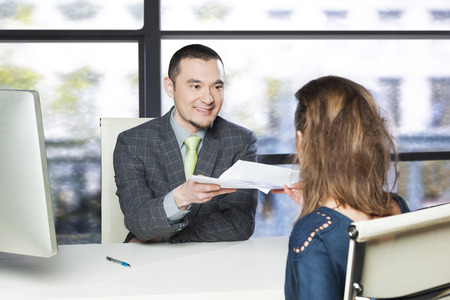 asian success: Successful job interview Stock Photo