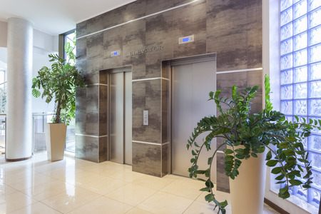Two elevators in a modern building Banco de Imagens