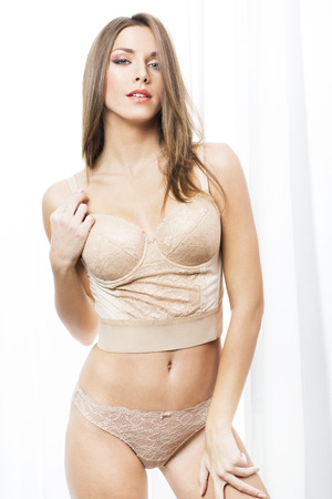 young woman panties: Sexy woman in beige lingerie