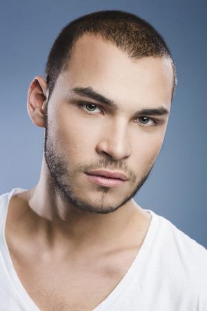v neck: Handsome young man portrait Stock Photo