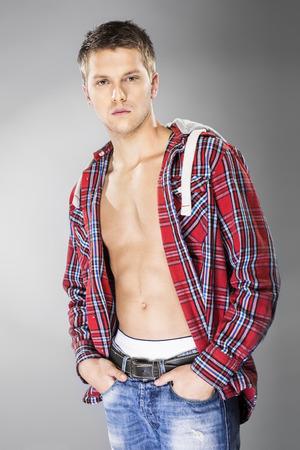 unbuttoned: Handsome blond man in unbuttoned shirt