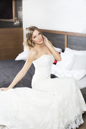 adult mermaid: Bride in beautiful white dress on bed