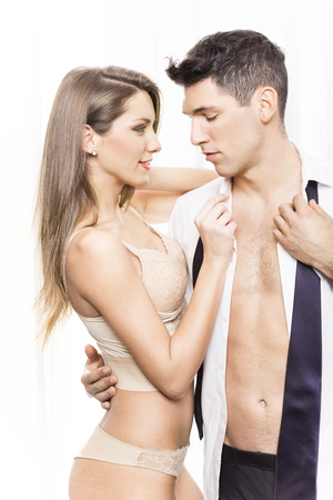 women undressing: Sexy couple in semi-dress