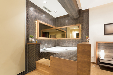 corner tub: Modern open jacuzzi in room Stock Photo